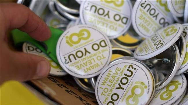 Anti-EU badges are pictured during a UK Independence Party pro-Brexit campaign event, ahead of the then-forthcoming referendum, in Birmingham, central England, May 31, 2016. (Photo by AFP)