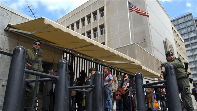 In this file photo, people waiting for US visas line up at the US embassy in Tel Aviv. (Photo by AP)