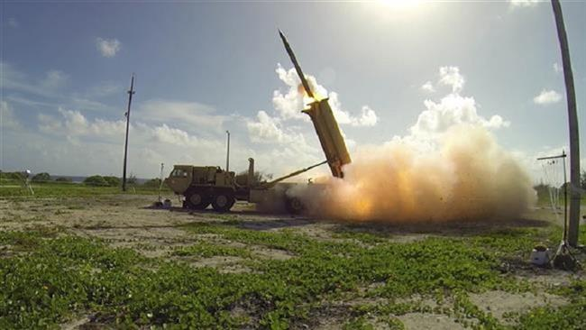 This US Department of Defense handout photo shows the launching of a Terminal High Altitude Area Defense (THAAD) missile on US Wake Island in the Pacific Ocean on November 1, 2015. (Via AFP)