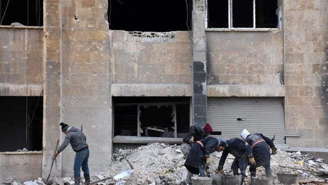 Syrian workers remove rubble on December 27, 2016, as they clean up the water station in Aleppo's Suleiman al-Halabi neighborhood. (Photo by AFP)