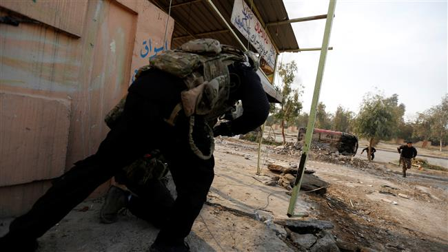 Iraqi Special Operations Forces (ISOF) clash with Takfiri Daesh terrorists near the Mosul University, January 13, 2017. (Photo by Reuters)