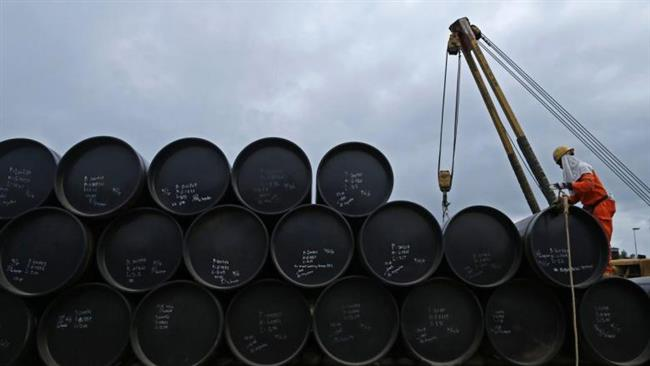 A worker prepares to transport oil pipelines