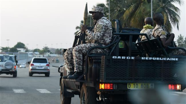 Ivorian soldiers from the Republican Guard arrive in Yamoussoukro from Abidjan, January 17, 2017. (Photo by AFP)