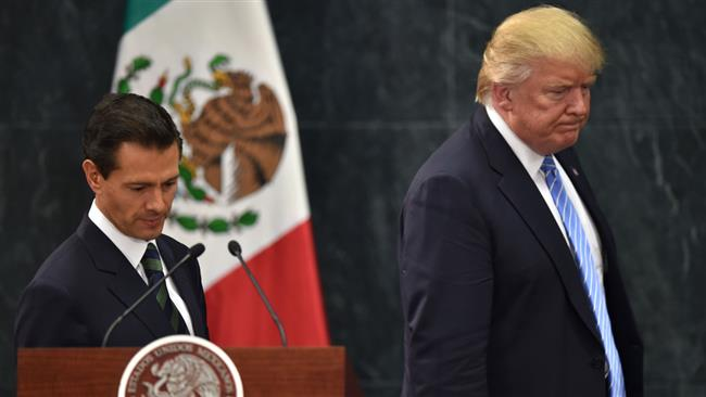 US Republican presidential nominee Donald Trump and Mexico's President Enrique Pena Nieto arrive for a press conference at the Los Pinos presidential residence in Mexico City on Wednesday, August 30, 2016. (Photo Reuters)