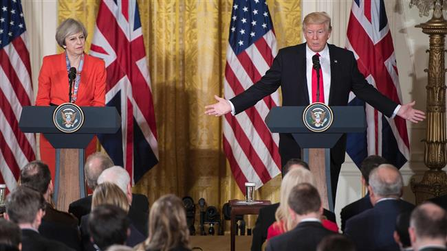 British Prime Minister Theresa May and US President Donald Trump speak during a press conference at the White House, in Washington, DC, January 27, 2017. (Photo by AFP)