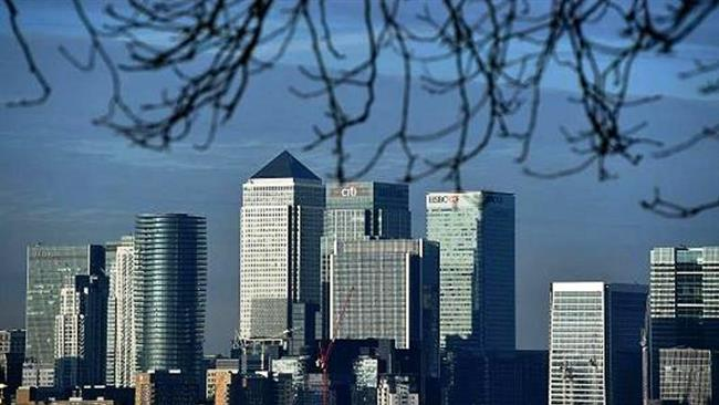 The financial offices of banks, including JPMorgan Chase, Citi, HSBC, and other institutions in the financial district of Canary Wharf, are pictured from Greenwich Park in London on January 17, 2017. (Photo by AP)