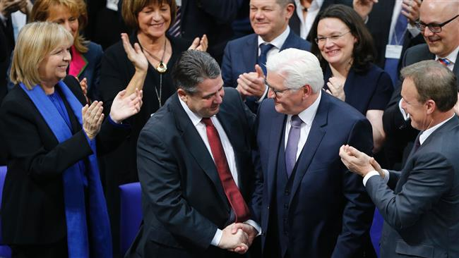 Newly-elected German President Frank-Walter Steinmeier (2nd R) is congratulated by German Vice Chancellor and Foreign Minister Sigmar Gabriel after the presidential election at the Bundesversammlung federal assembly Bundestag (lower house of parliament)on February 12, 2017 in Berlin. (Photo by AFP)