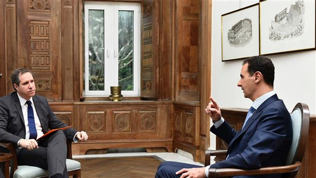 Syrian President Bashar al-Assad (R) gives an interview to Michel Scott from France's TF1 television in Damascus on February 16, 2017. (Photo by AFP)