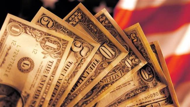 File photo shows different denominations of US dollars