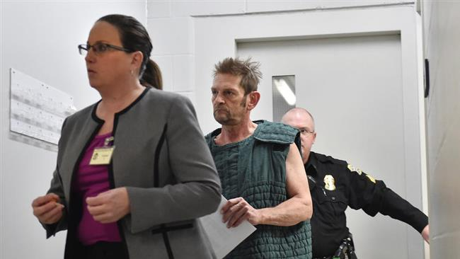 Adam Purinton, 51, accused of killing an Indian software engineer, is shown in closed circuit TV in court from the Johnson County detention center as Purinton heads towards a room with his public defender, Michelle R. Durrett (L) during his initial court appearance in Olathe, Kansas, February 27, 2017. (Photo by Reuters)