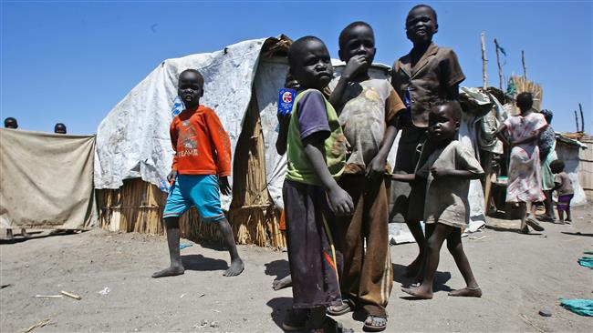 """South Sudanese refugees are seen at a """"Refugee Waiting Centre"""" in Al-Eligat area along the border in Sudan's White Nile state. (Photo by AFP)"""