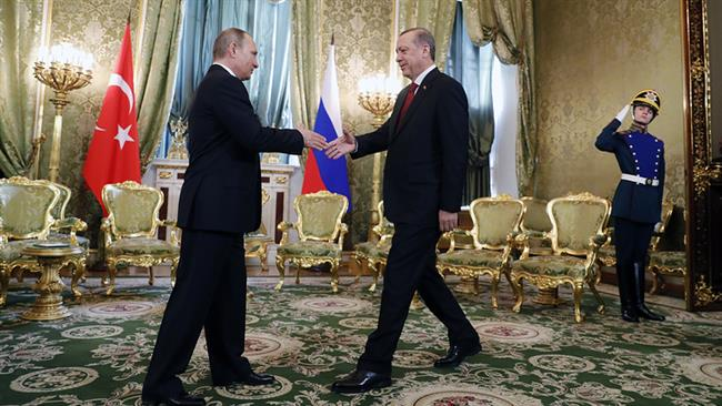 Russian President Vladimir Putin (L) shakes hands with his Turkish counterpart Recep Tayyip Erdogan in the Kremlin, Moscow, Russia, on March 10, 2017. (Photo by TASS news agency)
