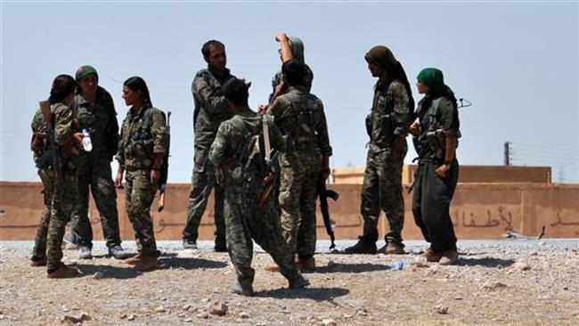 Forces with the Kurdish People's Protection Units (YPG) are seen in the northern Syria province of Raqqah on July 10, 2015. (Photo by AFP)