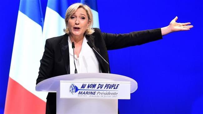 French far-right presidential candidate Marine Le Pen speaks on stage during a campaign rally at the Zenith de Nantes venue in Saint-Herblain on February 26, 2017. (Photo by AFP)