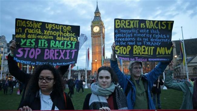 Protesters hold up anti-Brexit placards as they take part in a protest in support of an amendment to guarantee legal status of EU citizens, outside the Houses of Parliament in London on March 13, 2017. (Photos by AFP)