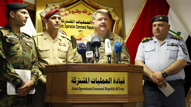 US Air Force Colonel John L. Dorrian (C), spokesman for the US-led coalition in Iraq and Syria, speaks during a press conference in the capital Baghdad on April 11, 2017. (Photo by AFP)