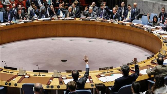 Members of the Security Council raise their hands as they vote in favor on a draft resolution that condemns a suspected chemical weapons attack in Syria, New York, April 12, 2017. (Photos by AFP)