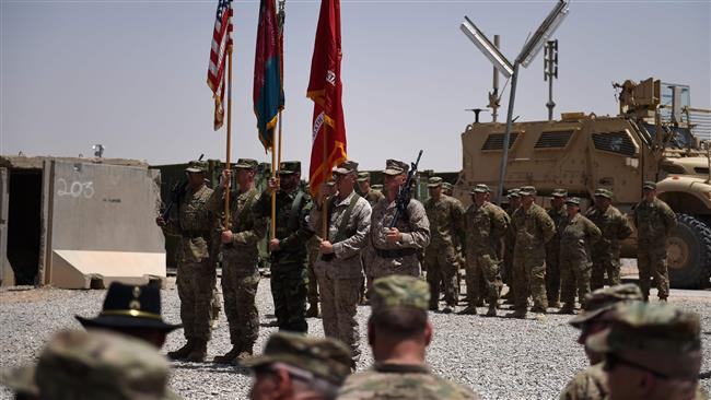 US Marines and Afghan National Army (ANA) personnel hold flags during a handover ceremony at Leatherneck Camp in the Afghan province of Helmand, on April 29, 2017. (Photo by AFP)