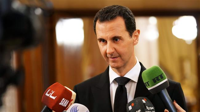 This handout picture released by Syria's official news agency on December 18, 2017, shows Syrian President Bashar al-Assad speaking to the press in Damascus. (Via AFP)