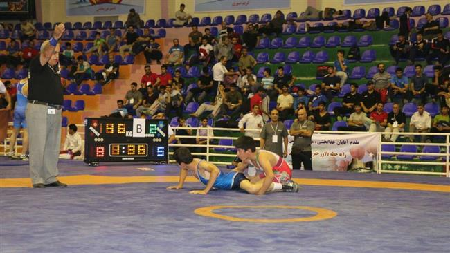 Iranian student wrestlers compete during a national tournament in Khorramabad, western Iran, on August 5, 2017.