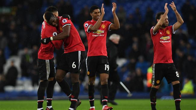 England's midfielder Jesse Lingard (L) gestures with Manchester United's French midfielder Paul Pogba (2L) as England's striker Marcus Rashford (2R) and Manchester United's Spanish midfielder Juan Mata applaudafter the English Premier League football match between Everton and Manchester United at Goodison Park in Liverpool, north west England on January 1, 2018. (AFP)