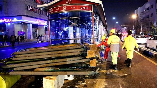 The photo shows a damaged bus station following violent clashes in downtown Tehran, Iran, December 31, 2017. (By Fars news agency)