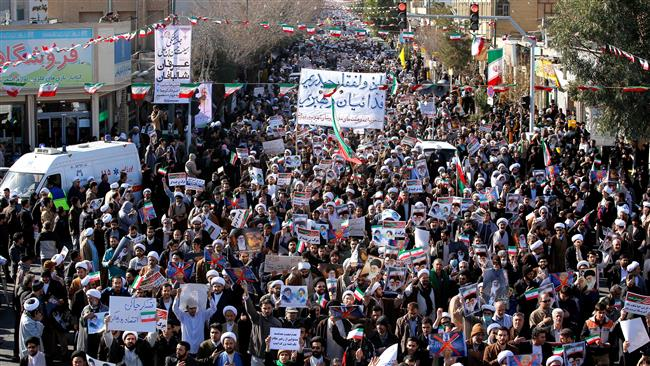 Pro-government demonstrators march in Iran's holy city of Qom, some 130 kilometers south of Tehran, on January 3, 2018. (Photo by AFP)