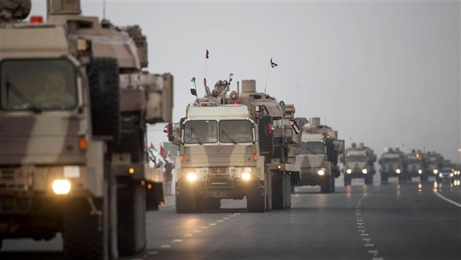 This photo released by Emirati media shows a convoy of UAE military personnel arriving in Abu Dhabi after taking part in military operations in Yemen on November 7, 2015.