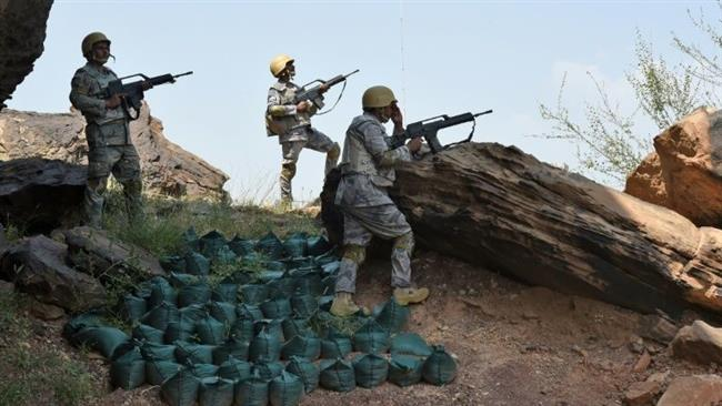 In this file photo, Saudi border guards keep watch along the border with Yemen in the al-Khubah area.