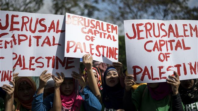Muslim demonstrators hold up anti-US placards during a protest near the Israeli embassy in Manila on December 21, 2017, against US President Donald Trump. (Photo by AFP)