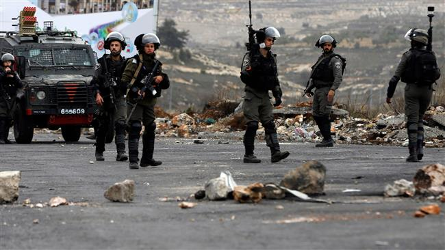 Israeli forces stand guard during clashes with Palestinian demonstrators following the weekly Friday prayers in the occupied West Bank city of Ramallah on December 29, 2017. (Photo by AFP)
