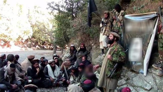 This file photo purportedly shows a number of militants being trained at a camp of the Daesh Takfiri terrorist group in an unknown location in Afghanistan.