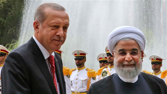 This photo provided by the Iranian president's office shows Iran's President Hassan Rouhani (R) and his Turkish counterpart Recep Tayyip Erdogan during a welcome ceremony in Tehran on October 4, 2017. (Photo by AFP)