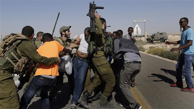 African migrants clash with Israeli soldiers after they left the Holot detention center on June, 27, 2014.