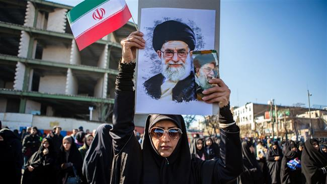 An Iranian woman holds the picture of Leader of the Islamic Revolution Ayatollah Seyyed Ali Khamenei during a pro-establishment demonstration in response to recent violent riots in a number of Iranian cities. (Photo by IRNA)