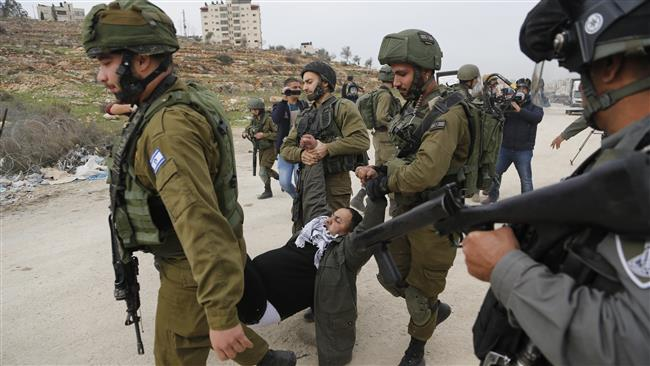 Israeli forces detain a Palestinian demonstrator during a protest near the West Bank city of Ramallah, December 28, 2017. (Photo by AP)