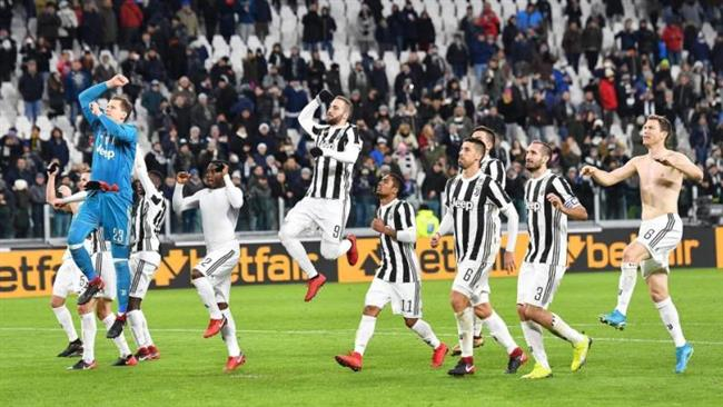 Juventus players celebrate after defeating Torino 2-0 and qualifying for the Coppa Italia semifinals. (AP)