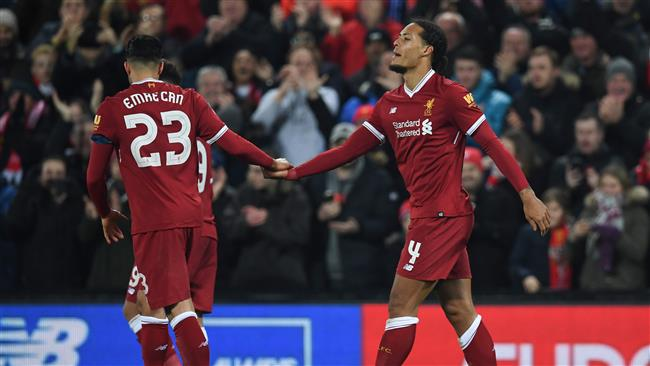 Liverpool's Dutch defender Virgil van Dijk (R) celebrates scoring their second goal during the English FA Cup third round football match between Liverpool and Everton at Anfield in Liverpool, north west England on January 5, 2018. (AFP)