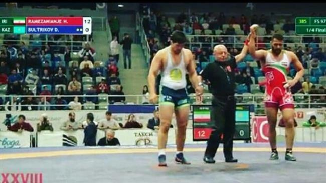 Iranian freestyle wrestler Hossein Ramezanian (in red singlet) wins against Kazakhstan's Duman Bultrikov at the end of their men's 97-kilogram quarterfinal bout on January 29, 2017, during the Golden Grand Prix Ivan Yarygin 2017 in Krasnoyarsk, Russia.