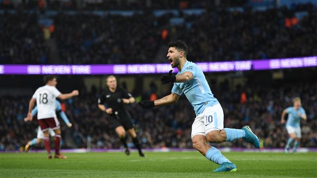 Manchester City's Argentinian striker Sergio Aguero celebrates scoring their first goal to equalise 1-1 during the English FA Cup third round football match between Manchester City and Burnley at Etihad Stadium in Manchester, north west England on January 6, 2018. (AFP)