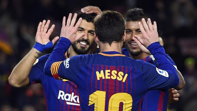 Barcelona's Brazilian midfielder Paulinho (R) celebrates a goal with Barcelona's Argentinian forward Lionel Messi and Barcelona's Uruguayan forward Luis Suarez (L) during the Spanish league football match FC Barcelona vs Levante UD at the Camp Nou stadium in Barcelona on January 7, 2018. (AFP)