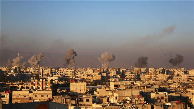 Smoke rises from buildings following air strikes in Eastern Ghouta outskirts of the capital Damascus on January 8, 2018. (AFP)
