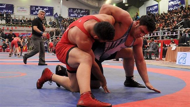 Wrestlers compete during the 14th edition of Shahid Hasheminejad Freestyle Wrestling Cup in Behshahr, northern Iran, on February 10, 2017.
