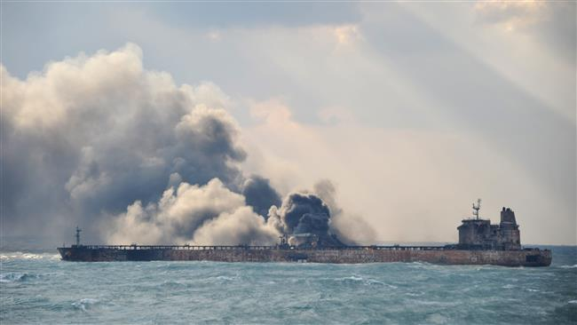 """This handout picture taken on January 9 and released on January 10, 2018 by the Transport Ministry of China shows smoke and flames coming from the burning oil tanker """"Sanchi"""" at sea off the coast of eastern China. (Photo by AFP)"""
