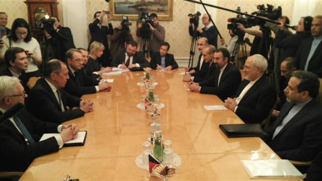 Iranian Foreign Minister Mohammad Javad Zarif (2nd-R) and Russian Foreign Minister Sergei Lavrov (2nd-L) meet in Moscow on January 10, 2018.