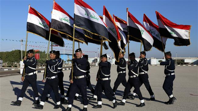 Iraqi policemen take part in a parade to mark the national police day on January 9, 2018 in the holy city of Najaf. (Photo by AFP)