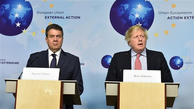 German Foreign Minister Sigmar Gabriel (L) and (R) British Foreign Secretary Boris Johnson take part in a press conference at the EU headquarters in Brussels on January 11, 2018. (AFP)