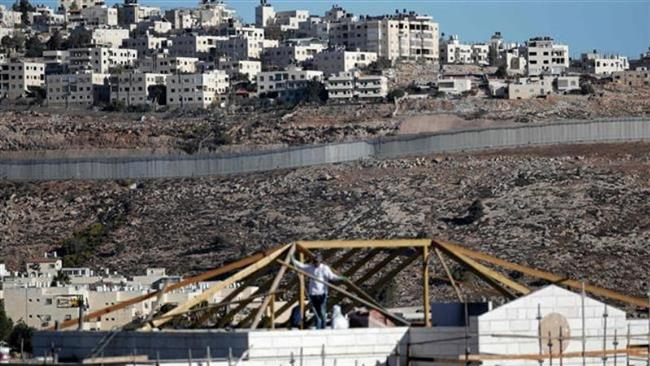 Buildings are seen under construction in the Israeli settlement of Pisgat Zeev. (Photo by AFP)