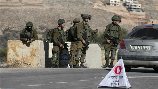 Israeli soldiers are seen at a checkpoint near the West Bank city of Nablus on January 11, 2018. (AFP)