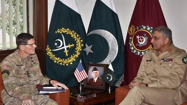 This file photo shows Pakistan Army Chief General Qamar Javed Bajwa (R) talking to US Central Command Chief General Joseph Votel.